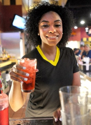 Bartender serving alcohol